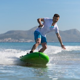 A man in his forties riding a green Lampuga Jetboard